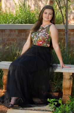 floral embroided bodice with black mesh skirt
