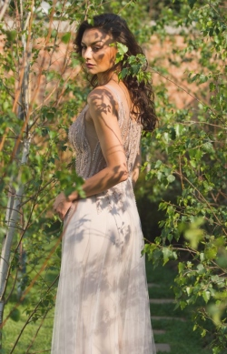 beaded bodice with nude mesh skirt